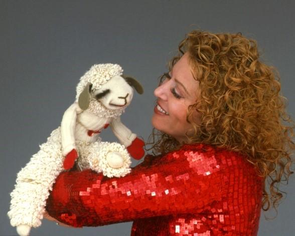 Mallory Lewis with lamb puppet Lamb Chop
